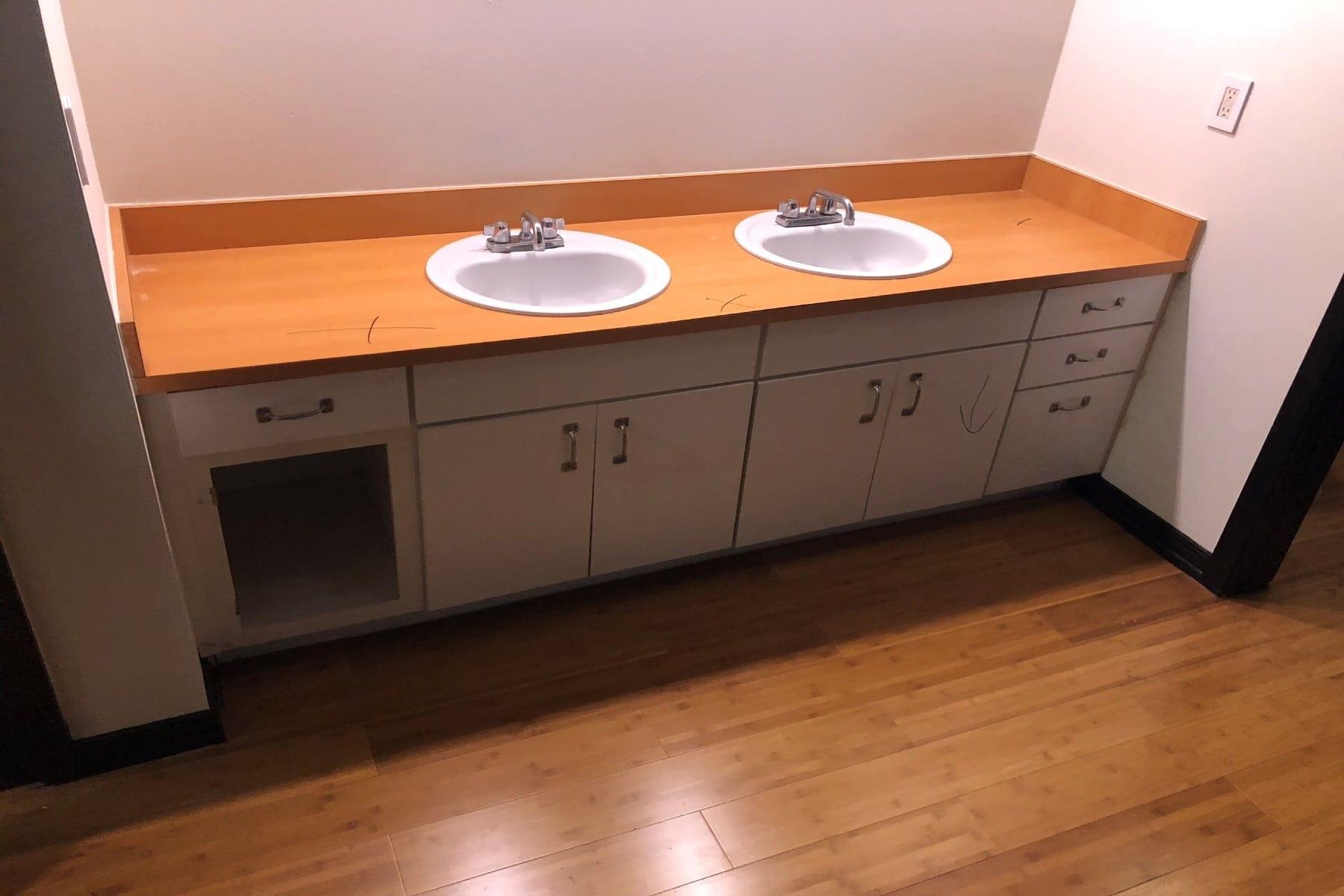 Vanity Before Uptown Condo Bathroom Remodel in Master Bath