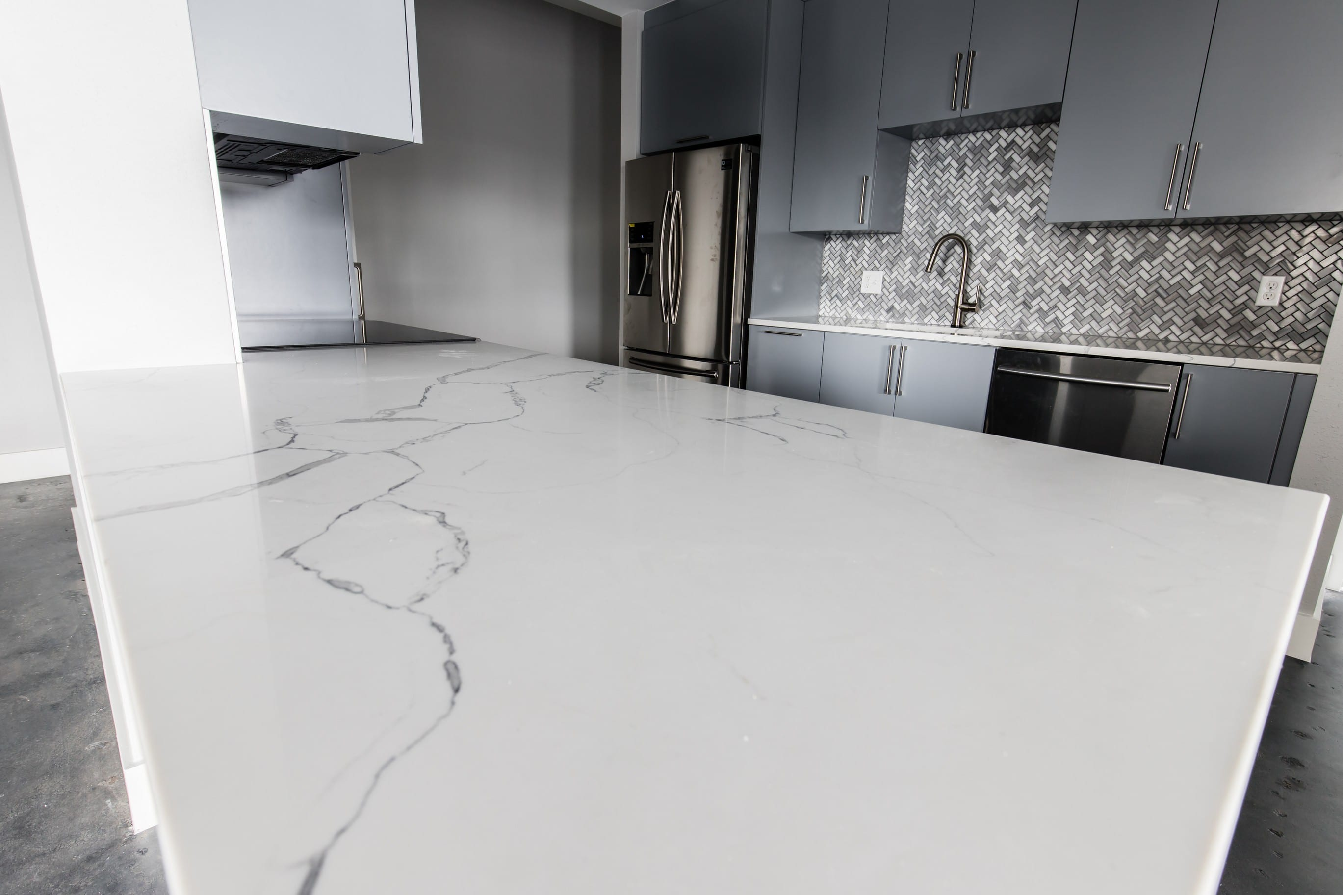 The Kitchen Countertops Are Simple Yet Stunning Featuring Statuary Clique Quartz From Msi Surfaces Which Is