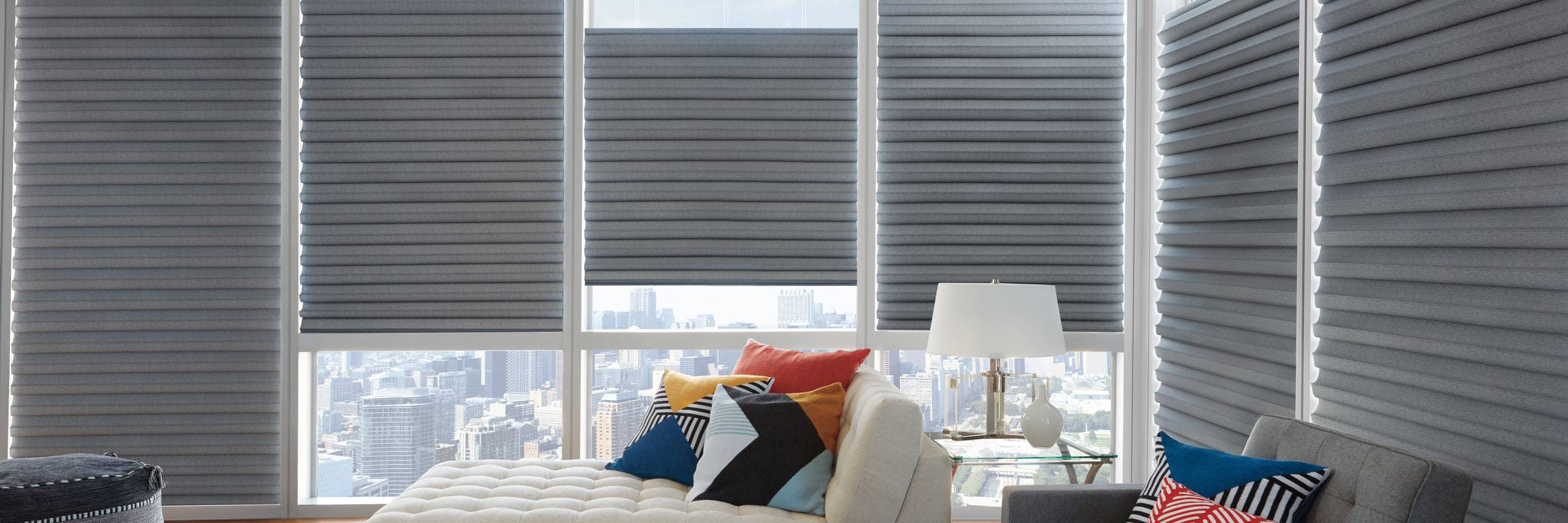 Made of woven and non-woven fabrics, Solera® Soft Shades create a fluid, sculpted look. It is a soft shade with cellular construction available in both light-filtering and room-darkening options. Learn more about Solera® Soft Shades.