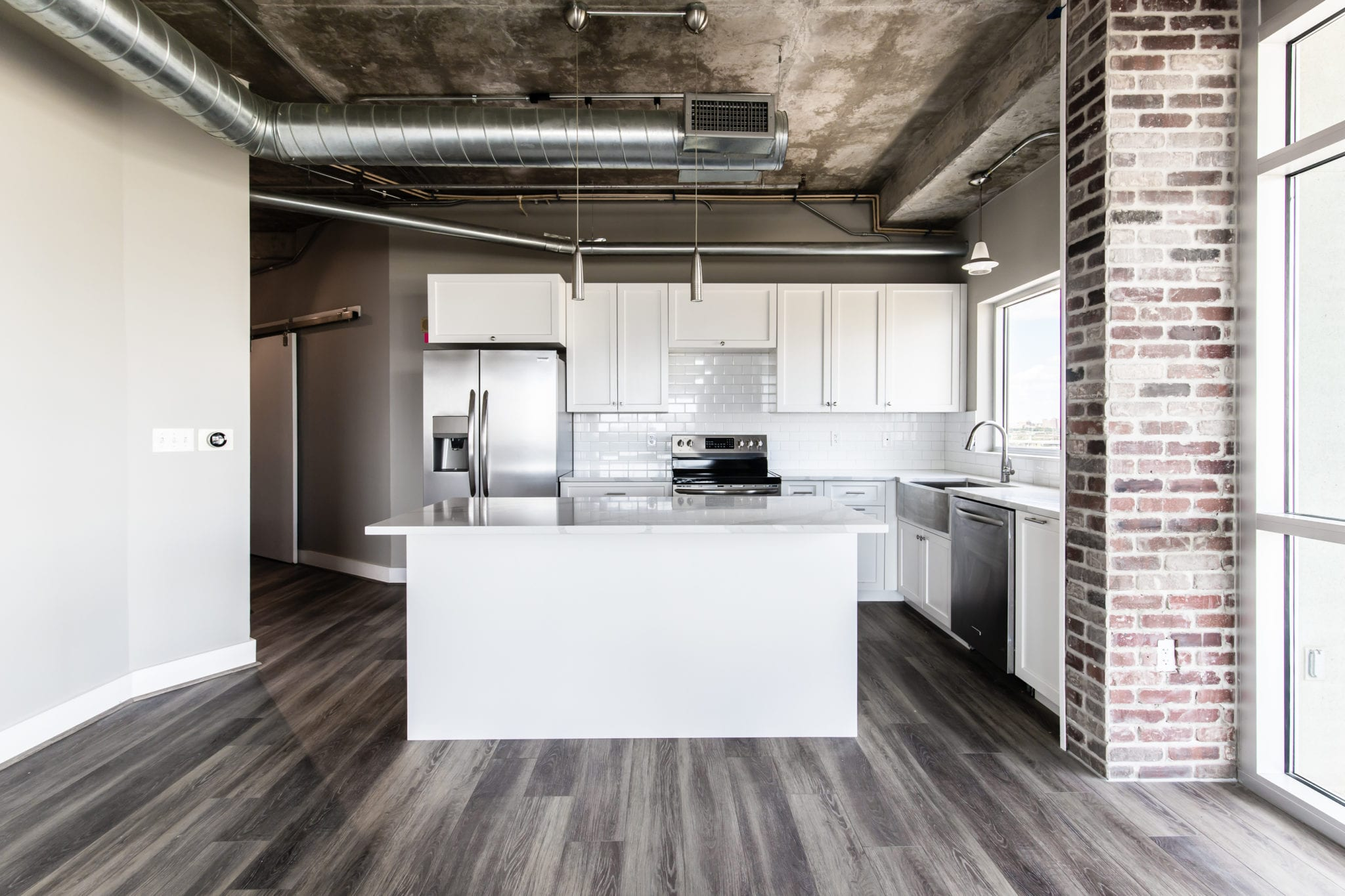 Mid-Rise-Dallas-Condo-Kitchen-After-Remodeling-with-extremely durable luxury vinyl floor by Shaw Floors. ALL ABOUT 'TIVOLI PLUS'