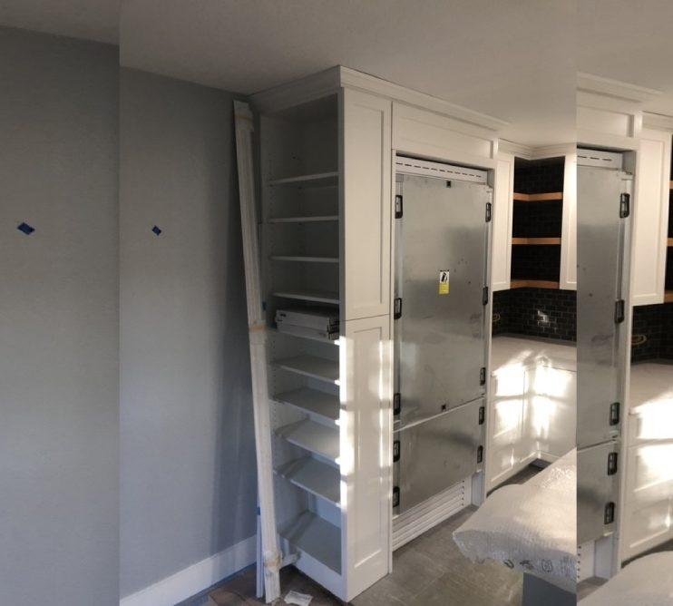 Dallas Condo During Kitchen Remodel Custom Cabinets with builtin panel ready for Bertazzoni Refrigerator