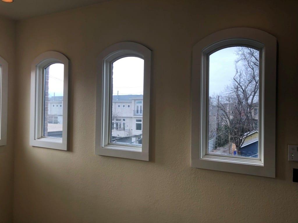 Turtle-Creek-town-Hone-Windows Before Hunter Douglas Shades in Stairwell