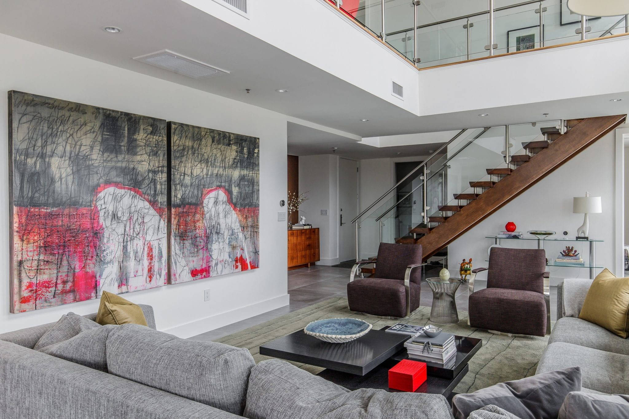Two Story High Rise Living Room Remodel