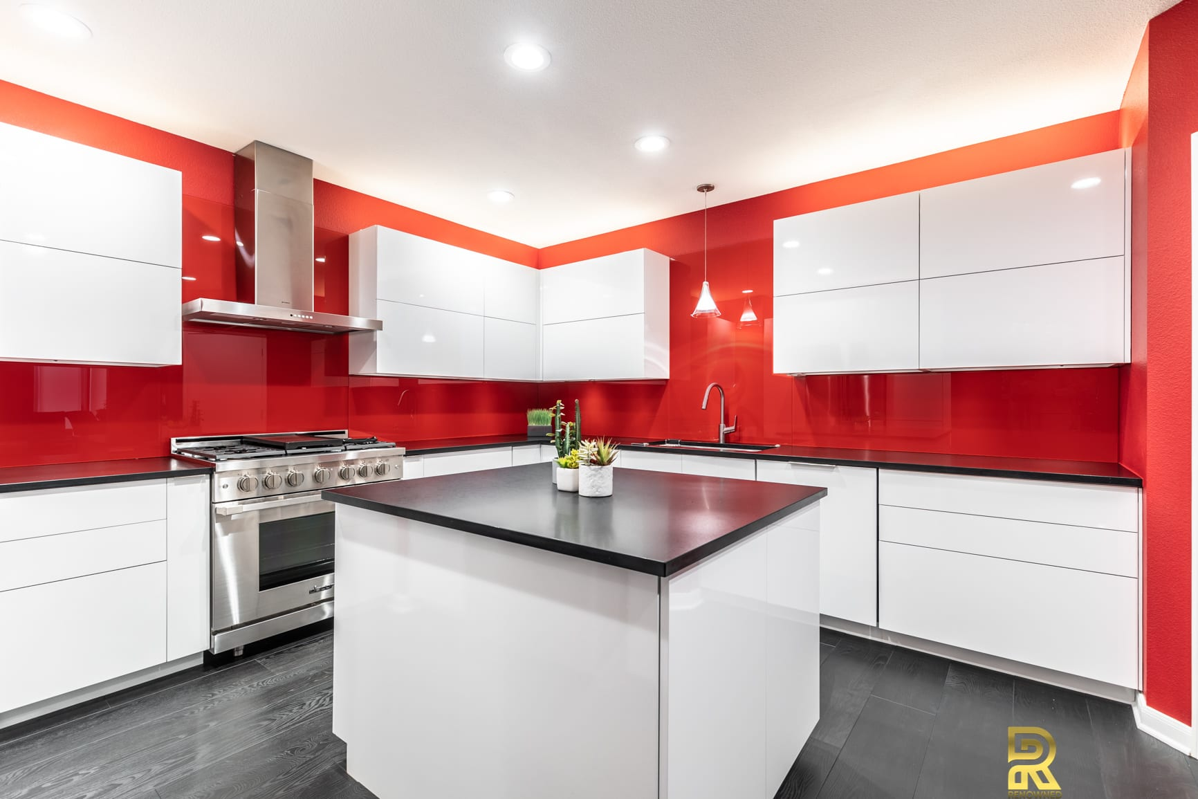 Red Hot Dallas High Rise Condo Kitchen with StyleCraft Custom After Remodeling by Renowned Renovation