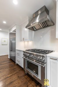 Luxury Kitchen Remodel Featuring Thermador Chimney Wall Hood